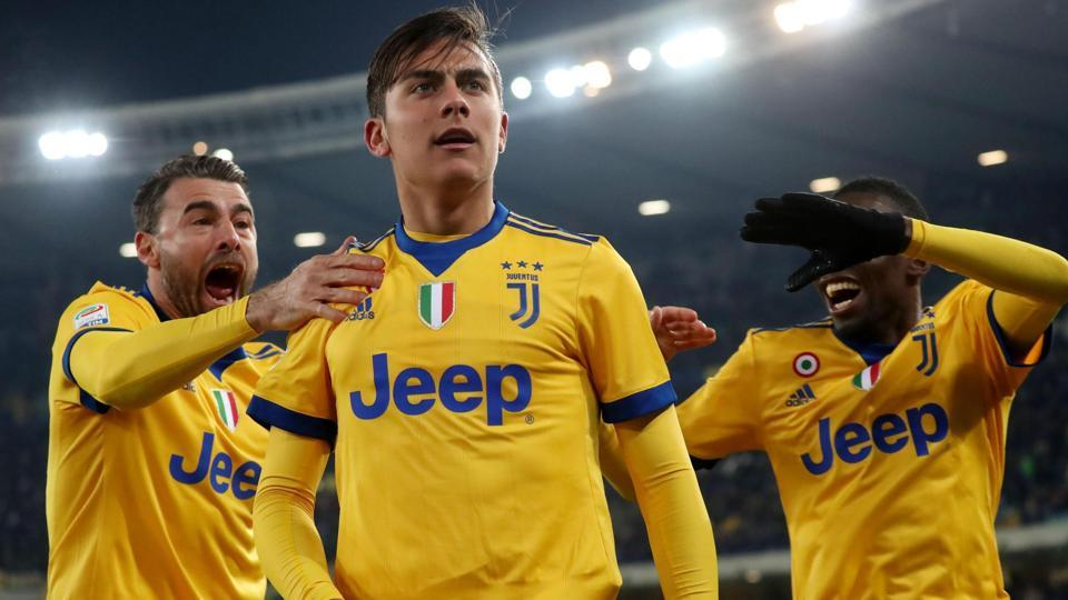 Juventus' Paulo Dybala, center, celebrates with teammates after scoring against Hellas Verona in their Serie A clash.