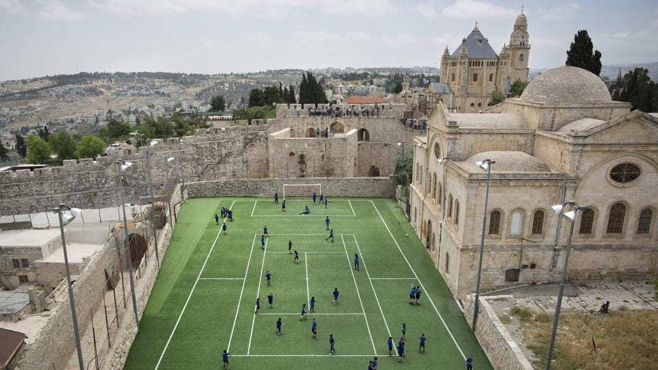 Armenian school kids play in the soccer field adjacent to Jerusalem's Old City Walls at the Sts. Tarkmanchatz Armenian School. The iconic Old City walls have been a symbol of the city, and successive waves of conflict surrounding it for centuries. (Oded Balilty / AP)