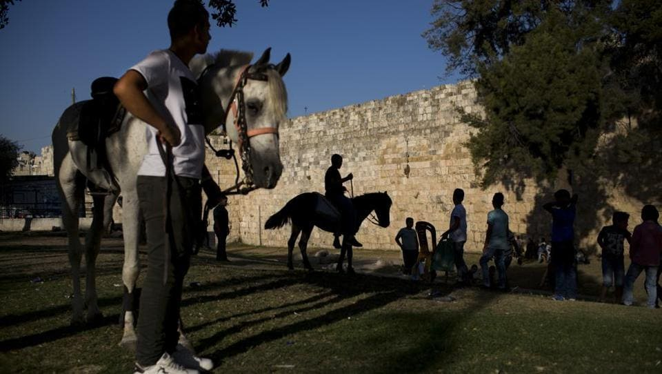 Palestinians ride horses during the Eid al-Fitr holiday outside Damascus Gate in Jerusalem. These conflicting claims have erupted into violence numerous times in the past. On December 6, 2017 President Donald Trump's recognition of Jerusalem as Israel's capital enraged Palestinians and much of the Muslim world. (Oded Balilty / AP)