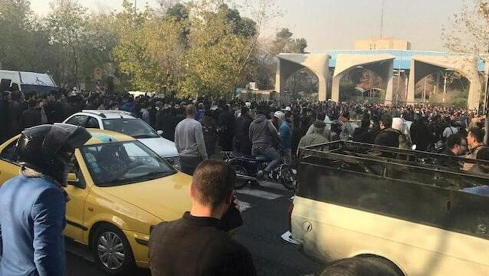 People protest near the university of Tehran on December 30, 2017 in this picture obtained from social media.