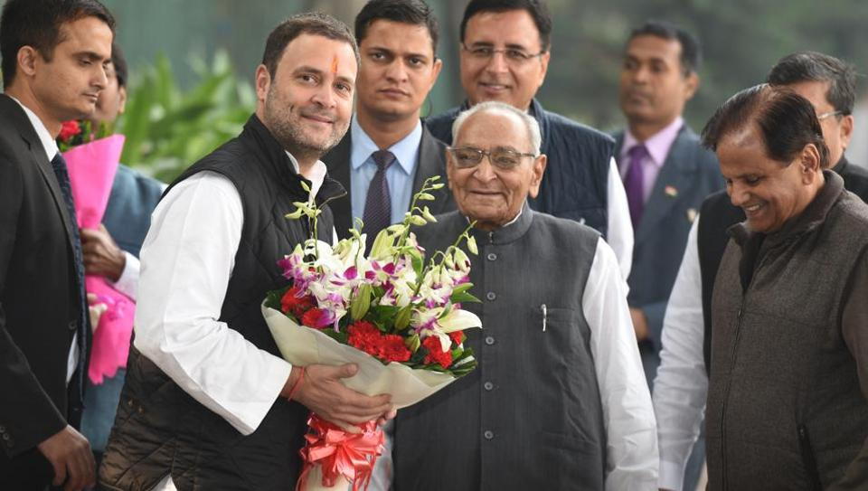 Rahul Gandhi being greeted by party leaders Ahmed Patel and Motilal Vohra in New Delhi