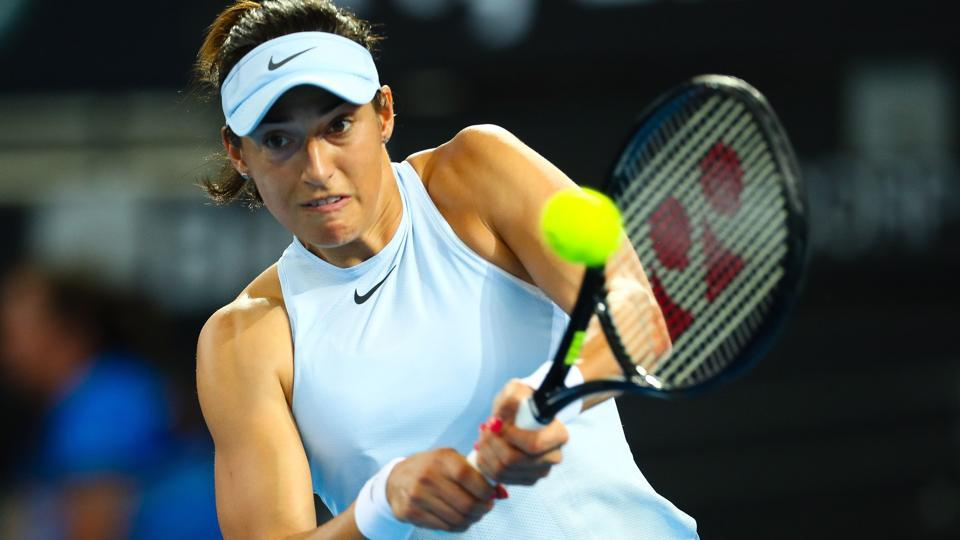 Caroline Garcia hits a return to compatriot Alize Cornet during their Brisbane International tennis encounter.