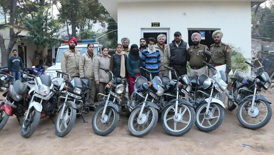 The accused and the seized vehicles in police custody at Phase 11 in Mohali on Sunday.