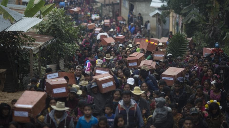 Ixil Mayans carry the remains of their loved ones  for burial in Guatemala. It wasn't only bullets and violence that killed thousands of indigenous people during 1960-1996 civil wars. The governments forced tens of thousands of farmers into model villages under strict army control to isolate them from guerrillas but instead were left to die of malnutrition and treatable illnesses. Now, in the hamlet of Santa Avelina, their bodies are being unearthed, identified and reburied. (Luis Soto / AP)