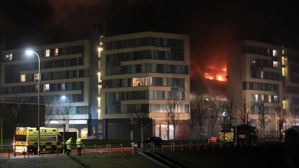 Emergency services attend the scene of a fire at a multi-storey car park on Liverpool's waterfront, northwest England, on December 31, 2017. Witnesses said cars seemed to explode every couple of seconds when the fire was at its peak.