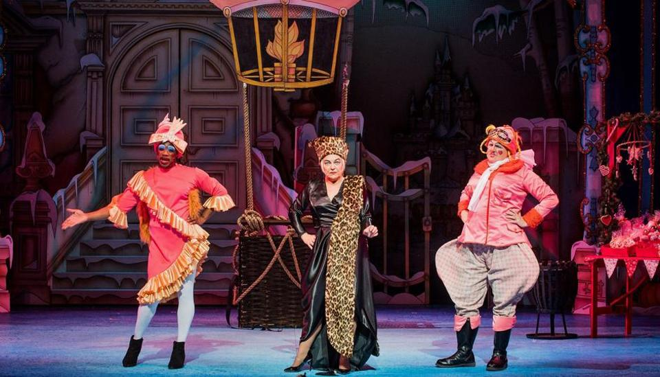Director and actor, Susie McKenna (C) performs with actors Kat B and Tony Whittle as the Ugly Sisters in a production of the pantomime 'Cinderella'.