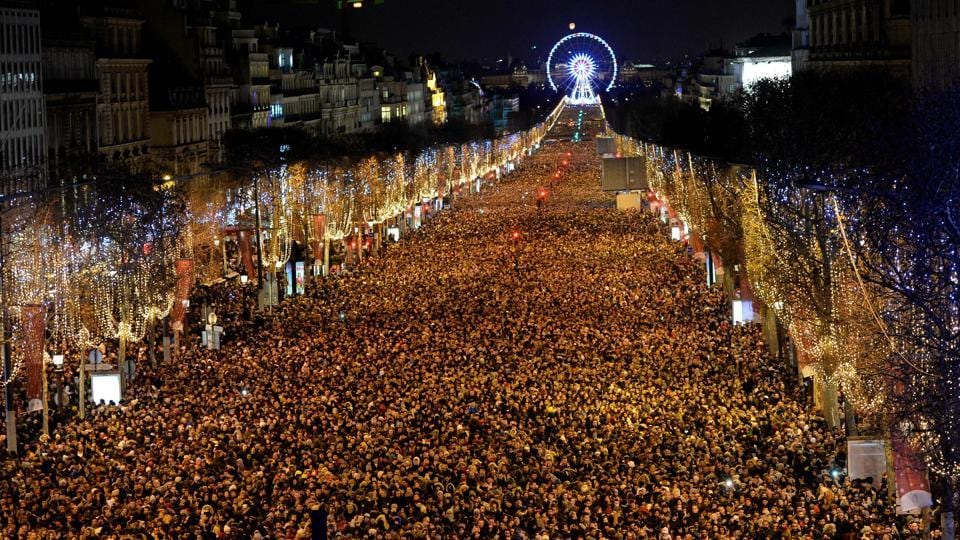New Year revellers gather on the Champs-Elysees avenue in Paris. (Guillaume Souvant / AFP)