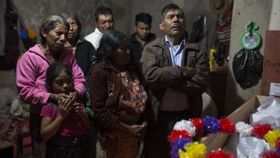 Baltazar Perez Sanchez, 71, mourns next to the coffin of his mother Magdalena, who died at age 65 in  Guatemala.The villages were created with government funds and support from US evangelical churches, which maintained close relations with then-dictator Efrain Rios Montt.  With the signing of peace accords in 1996, the model villages were gradually dismantled. (Luis Soto / AP)