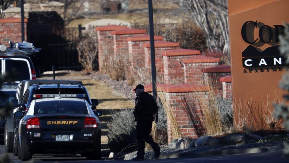 An investigator heads to the scene of shooting Sunday in Colorado.