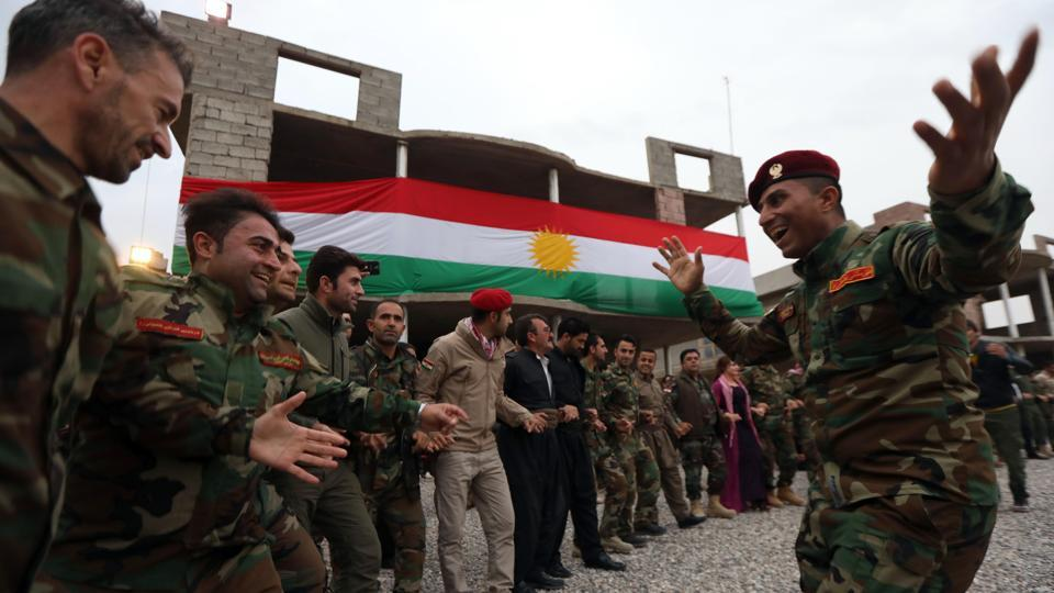 Iraqi Kurdish Peshmerga members dance during a gathering to celebrate the New Year on the frontline in Makhmur. (Safin Ahmed / AFP)