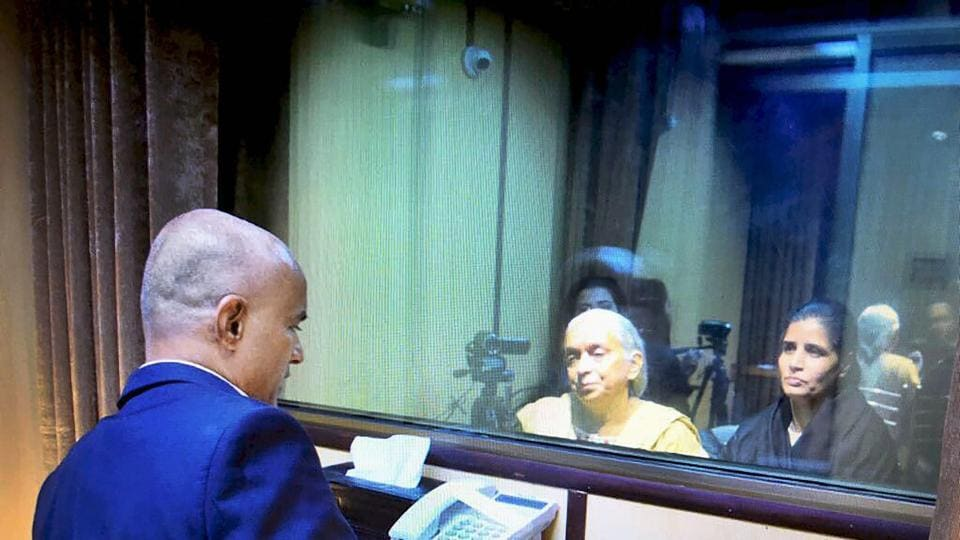 Former Indian Navy officer Kulbhushan Jadhav's wife and mother meet him while seated across a glass partition at the Pakistan Foreign Office in Islamabad on December 25.
