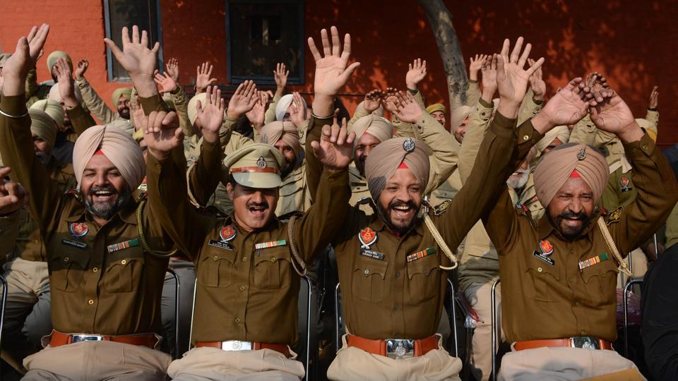 Police personnel participate in a 'laughing session' during New Year celebrations at the recruitment centre in Jalandhar on Monday.  (Pardeep Pandit/HT)