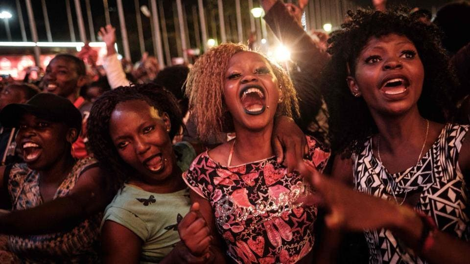 People react after counting down to New Year's day on January 1, 2018, during the New Year's music event at Kenyatta International Convention Centre (KICC) in Nairobi, Kenya. (Yasuyoshi Chiba / AFP)