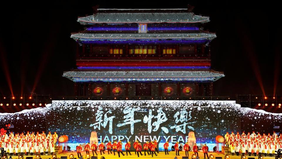 People dance to celebrate the new year during a countdown event at Yongdingmen Gate in Beijing, China. (Jason Lee / REUTERS)