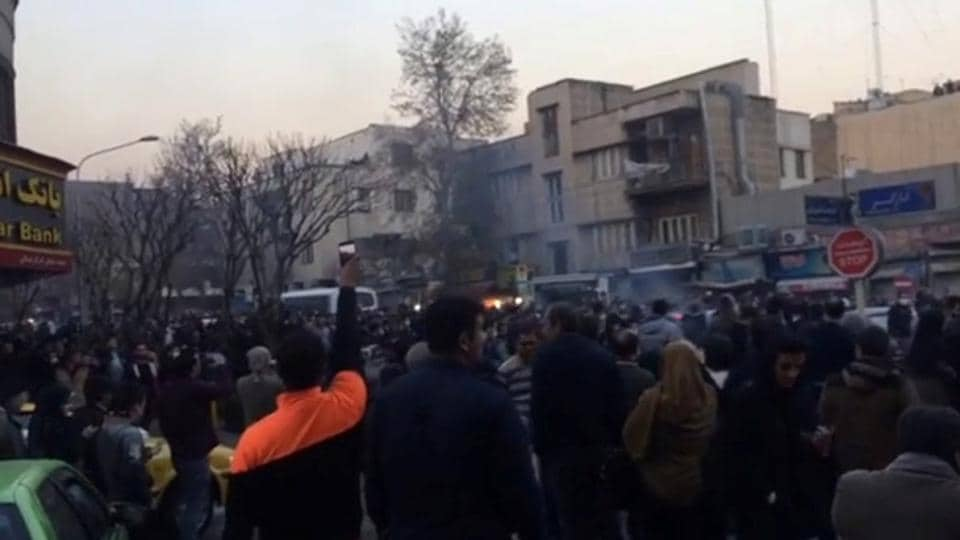 People protest in Tehran on December 30, 2017 in this still image from a video.