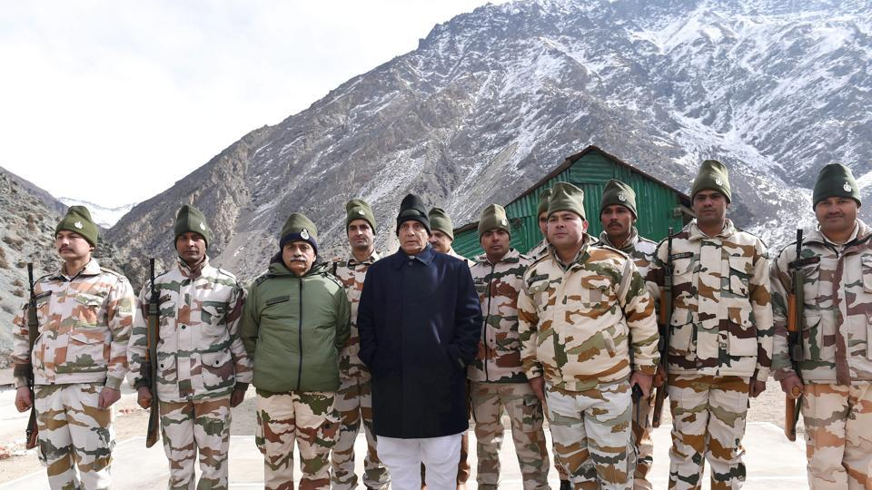 Union home minister Rajnath Singh with officers and jawans of Indo-Tibetan Border Police, at Nelong Border Out-Post, in Uttarkashi on Monday.