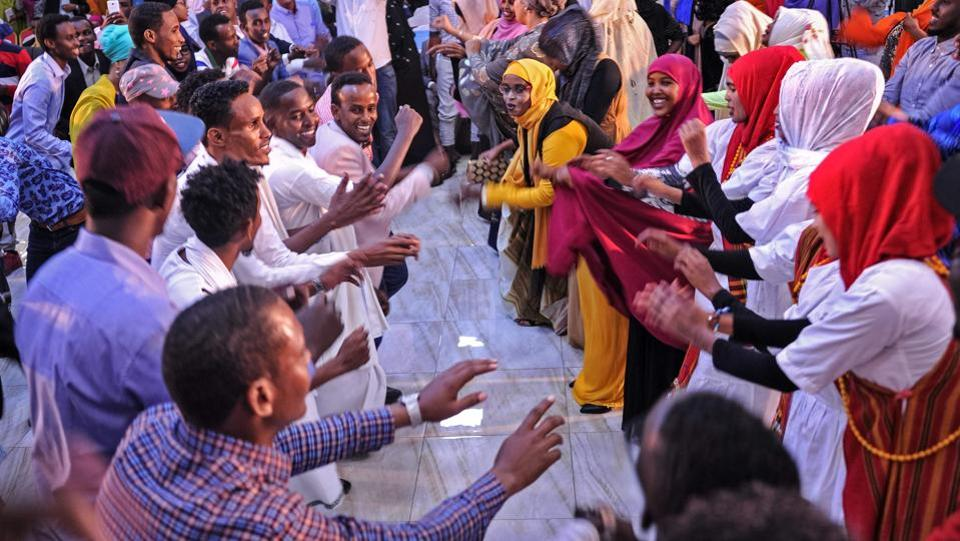 Somali women and men enjoy a traditional dance as they celebrate the coming 2018 on New Year's eve  in Mogadishu, Somalia. (Mohamed Abdiwahab / AFP)