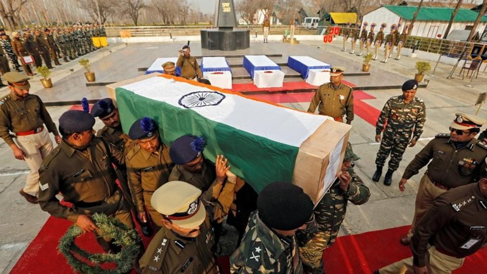 Central Reserve Police Force personnel carry a coffin containing a body of their colleague, who was killed during a gun battle with suspected militants at CRPF training centre, in Lethpora in south Kashmir's Pulwama district, on Sunday.