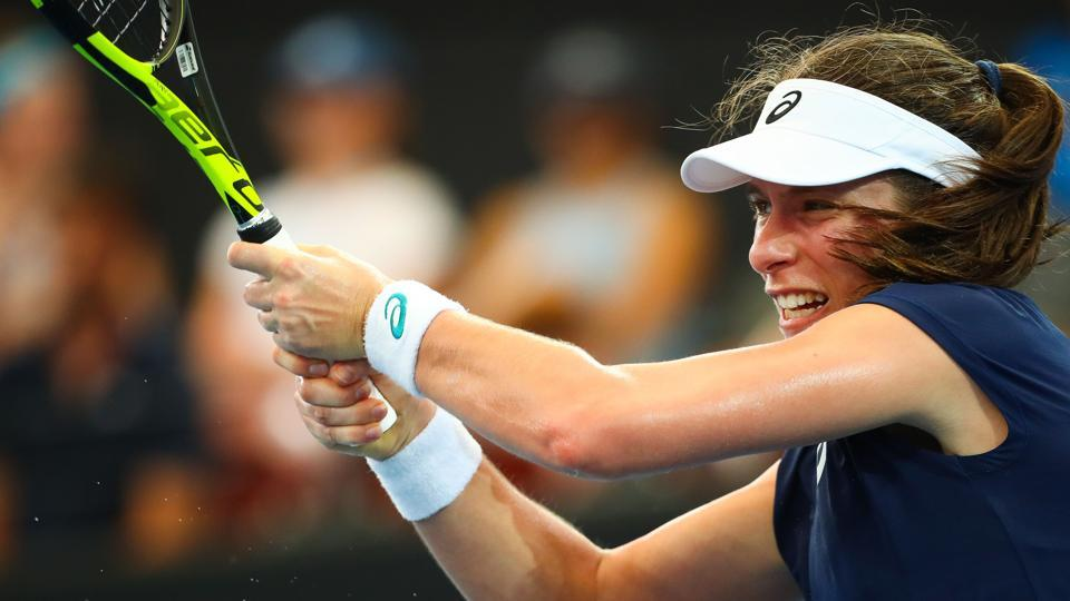 Johanna Konta of Britain hits a return against Madison Keys of the US during their first round women's singles match at the Brisbane International tennis tournament at the Pat Rafter Arena in Brisbane on Monday.