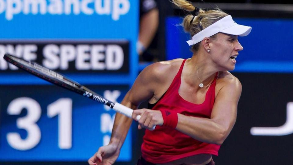 Angelique Kerber of Germany hits a return against Elise Mertens of Belgium during their women's singles match on day three of the Hopman Cup tennis tournament in Perth on  Monday.