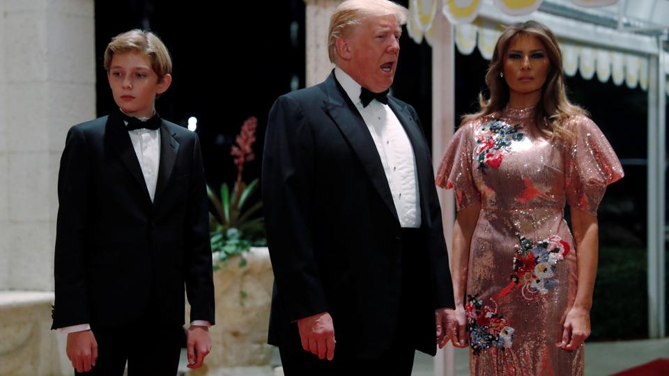 US President Donald Trump and first lady Melania Trump, with their son Barron, arrive for a New Year's Eve party at his Mar-a-Lago club in Palm Beach, Florida.