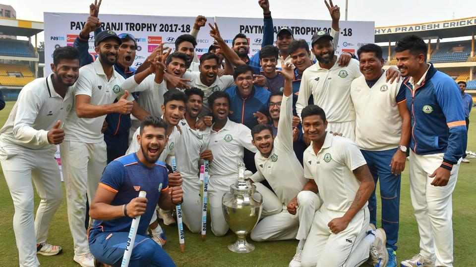 Washim Jaffer (3R) celebrates with Vidarbha teammates after winning the Ranji Trophy final against Delhi in Indore on Monday.
