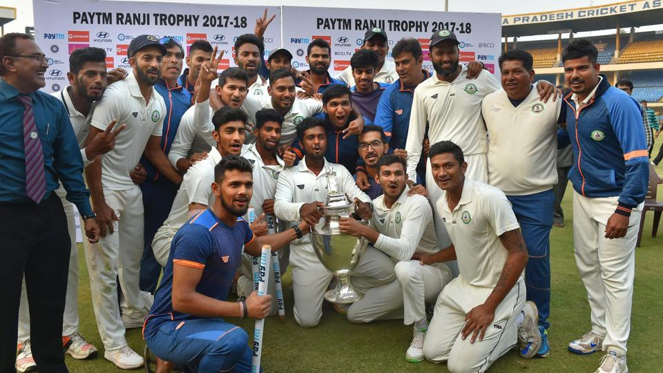 Vidarbha players celebrate with the trophy after winning the Ranji Trophy final against Delhi in Indore on Monday.