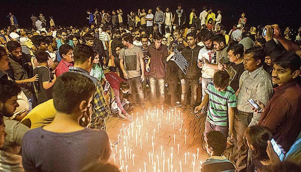 People participated in a candle march at Marine Drive in memory of Kamala Mills fire victims, on December 31.