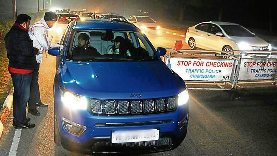 Traffic cops checking for drink driving at a naka near Matka Chowk on New Year's Eve in Chandigarh. In Panchkula, only 21 violators were fined while six challans were issued in Mohali.