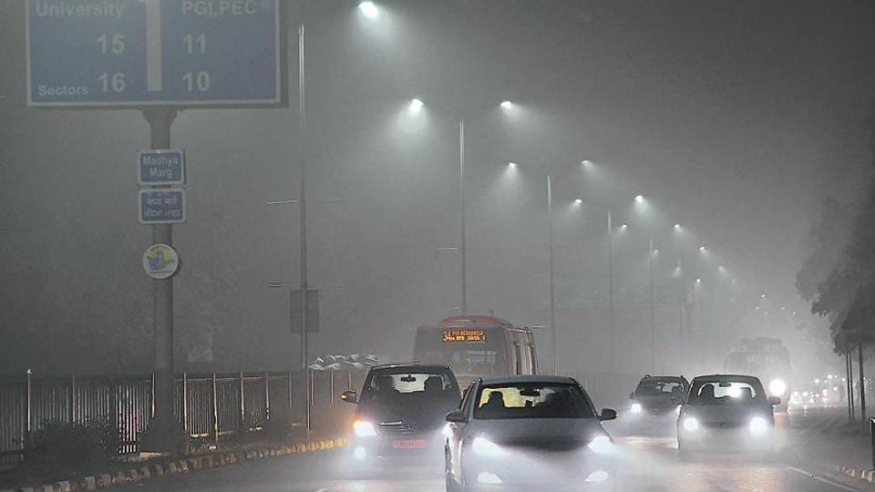 Dense fog made commuting in Chandigarh on Monday a nightmare.  (Karun Sharma/HT)