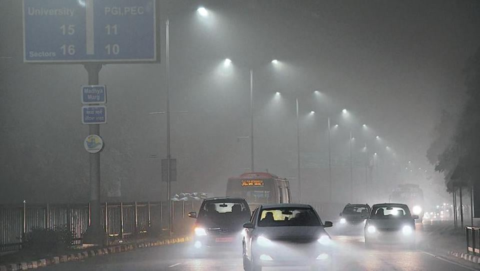 Dense fog made commuting in the city a nightmare too. A view of the Sector 10/16 road in Chandigarh around 7pm on Monday.