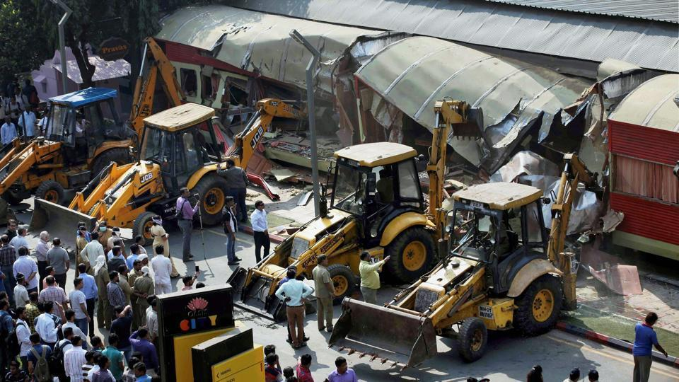 BMC bulldozers take down illegally constructed eateries in Kamala Mills compound following the fire, on Saturday.