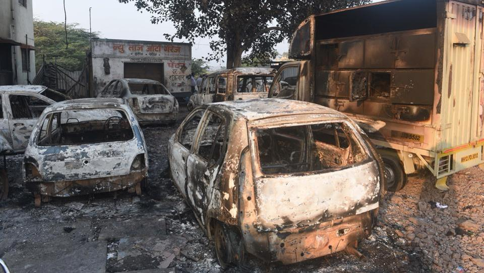 Torched and vandalized vehicles at Bhima Koregaon, Pune. The protests also took a political colour with Nationalist Congress Party chief Sharad Pawar blaming the government for not preventing Monday's violence. (Pratham Gokhale / HT Photo)