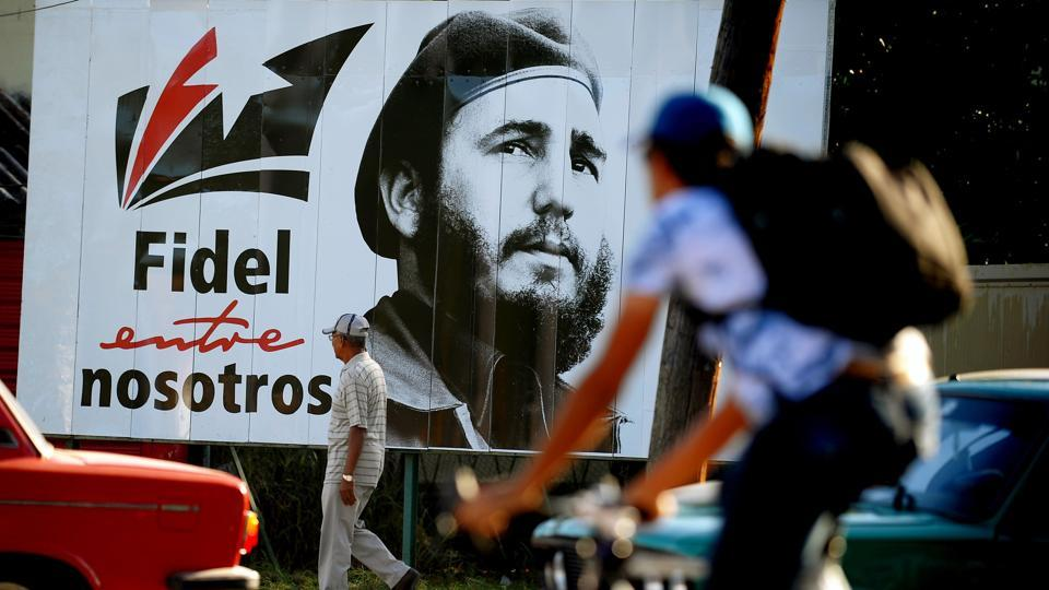 A man walks past a poster of late Cuban leader Fidel Castro, in Havana on November 24, 2017.