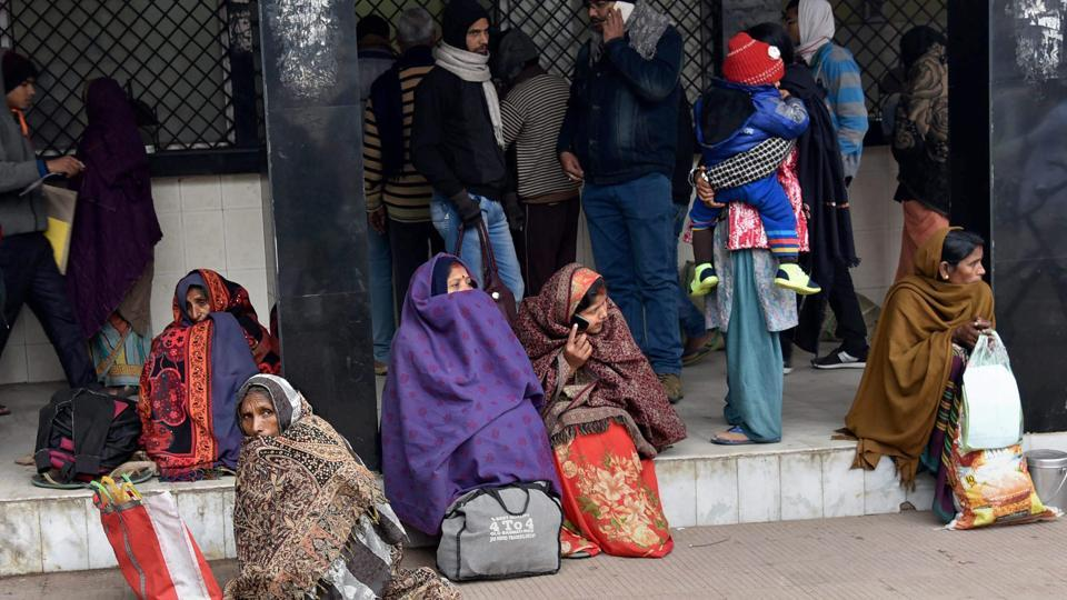 Relatives of patients wait outside a hospital while the doctors held a nationwide strike to protest the National Medical Commission Bill, in Patna on Tuesday.