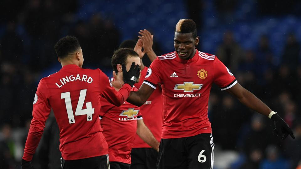 Anthony Martial and Jesse Lingard scored for Manchester United as they stayed 12 points behind Premier League leaders Manchester City.