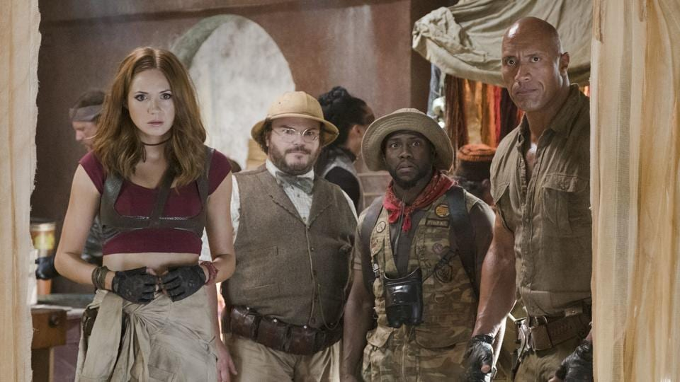 This image released by Sony Pictures shows Karen Gillan, from left, Jack Black, Kevin Hart and Dwayne Johnson in Jumanji: Welcome to the Jungle.