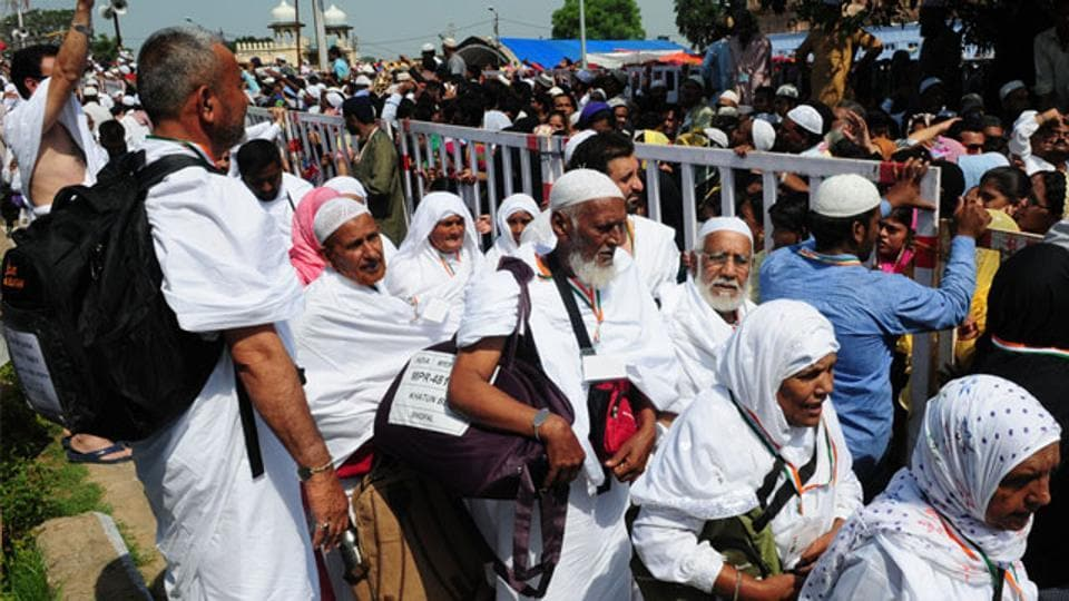 Pilgrims wave to relatives and friends at Taj-ul-masajid transit point before leaving for Haj in Bhopal.