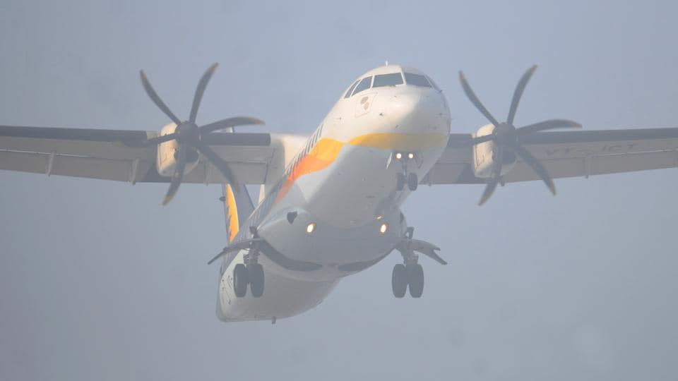 An airplane takes fligth on a foggy day in Chandigarh.  (Anil Dayal/HT)