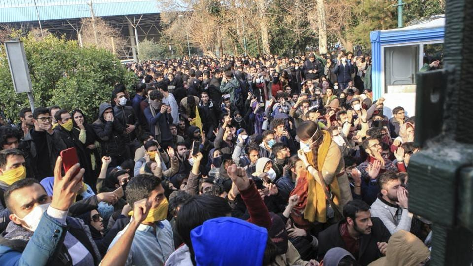 University students attend a protest inside Tehran University while anti-riot Iranian police prevent them from joining other protestors, in Tehran on December 30, 2017. As protests spread the Telegram app shut down a channel run by Roohallah Zam, an exiled journalist, after Iranian authorities complained that it was inciting violence and helped fan passions among those taking to the streets. (AP)