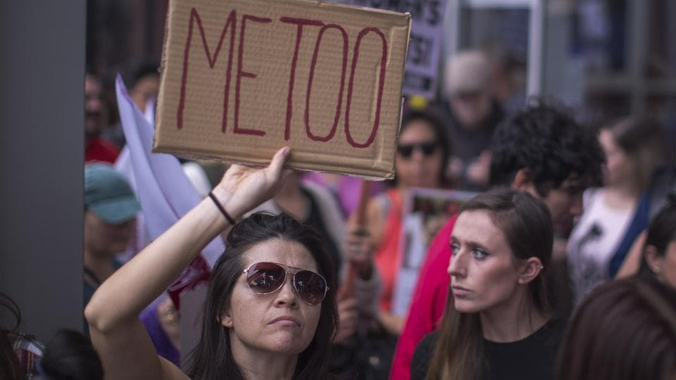 Demonstrators participate in the #MeToo Survivors's March in response to several high-profile sexual harassment scandals on November 12, 2017 in Los Angeles, California.