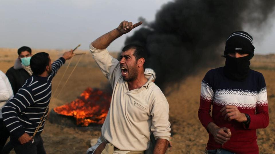A Palestinian demonstrator reacts during clashes with Israeli troops at a protest against US President Donald Trump's decision to recognize Jerusalem as the capital of Israel, near the border with Israel in the southern Gaza Strip on December 29, 2017.
