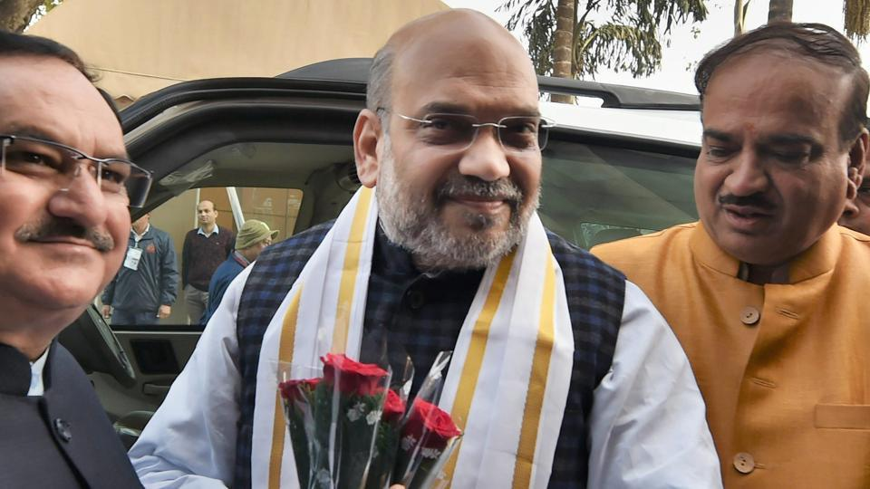 BJP president Amit Shah being welcomed by parliamentary affairs minister Ananth Kumar (R) on his arrival at Parliament, during the opening day of the winter session, in New Delhi on December 15, 2017.