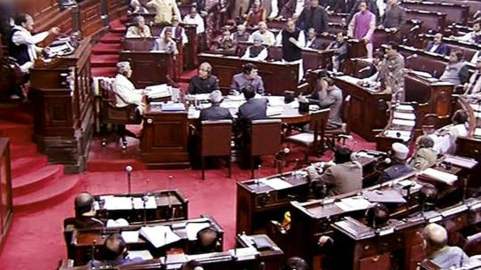 Opposition members protest inside the Rajya Sabha in New Delhi during the winter session of Parliament.