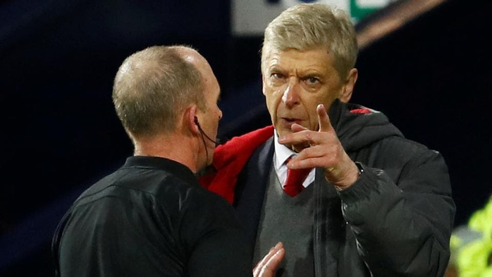 Arsenal manager Arsene Wenger remonstrates with referee Mike Dean after the latter awarded a penalty to West Brom during the Premier League game.