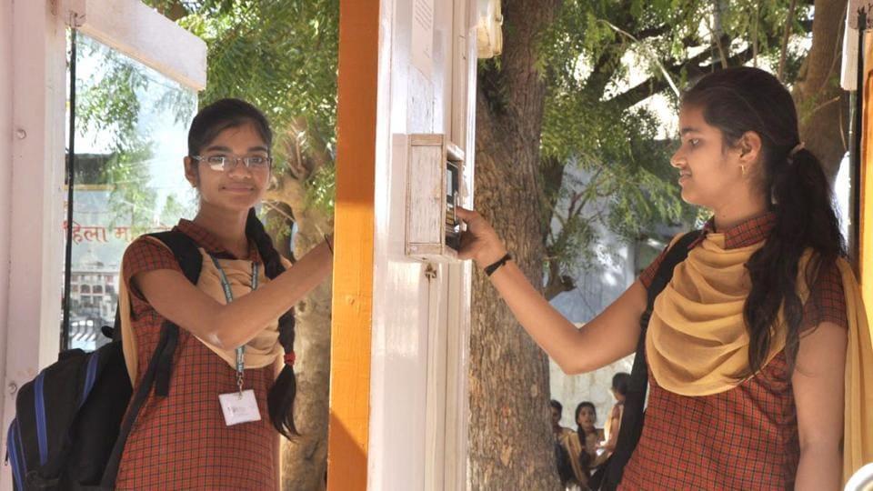 Girl students at Shri Bangad Mahila College in Nagaur's  Didwana marking attendance on a biometric machine.