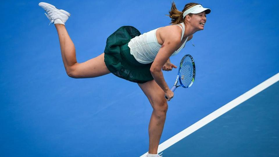 Russian tennis player Maria Sharapova hits a return against Alison Riske of the US during their women's singles second round match at the WTA Shenzhen Open on Tuesday.