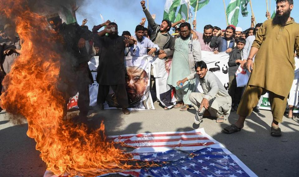 Protestors shout anti-US slogans at a march in Karachi on Tuesday.