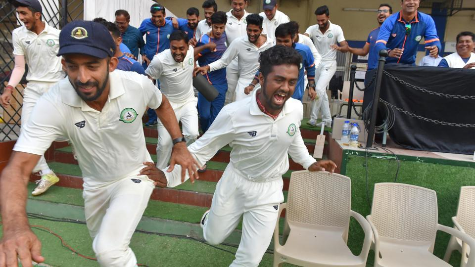 Vidarbha players celebrate after winning the Ranji Trophy final cricket match against Delhi by 9 wickets in Indore on Monday.