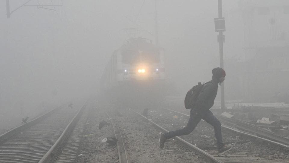 A man in Patna crosses a railway track as cold wave conditions continued to sweep across northern India on Tuesday. In Delhi, as many as 20 flights were delayed and six were cancelled, while 64 trains were delayed, 24 were rescheduled and 21 cancelled, while dense fog continued to shroud many places in Jammu and Kashmir and Punjab. (PTI)